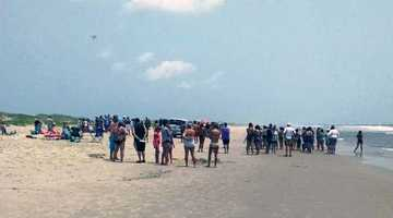 The 68-year-old was swimming in waist-deep water along Ocracoke Beach Wednesday afternoon when he was bitten