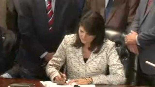 Gov. Nikki Haley speaks before signing the bill to remove the Confederate flag from the Statehouse grounds.