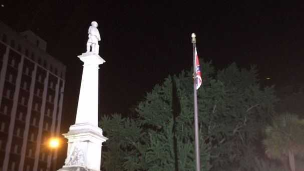 The Confederate monument and flag were illuminated hours before the ceremony to remove the flag.
