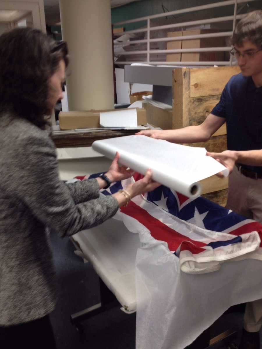 Rachel Cockrell, Registrar, and John Faulkenberry, Intern, pack the flag in an acid-free textile storage box, padded with acid-free tissue.  The box is stored in the Museum's secure, climate-controlled Artifact Storage area.Photos courtesy of the South Carolina Confederate Relic Room and Military Museum