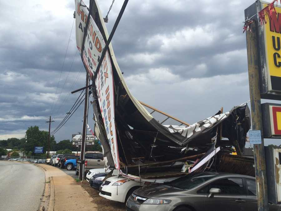A billboard fell on cars at Morgan Used Cars on Asheville Highway in Spartanburg. No word on what caused the billboard to fall, but winds from Monday night's storm is a possible cause.