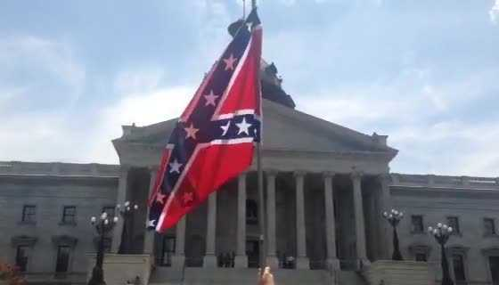 Protesters wait for KKK rally set to begin at 3