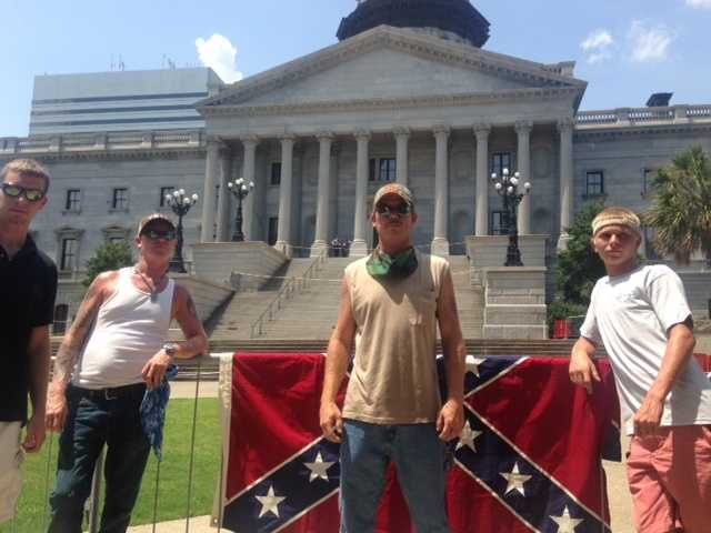 KKK barricaded in designated section for rally