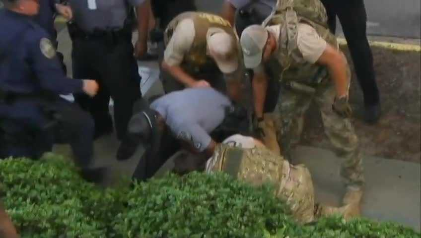 Man wrestled to the ground, arrested.