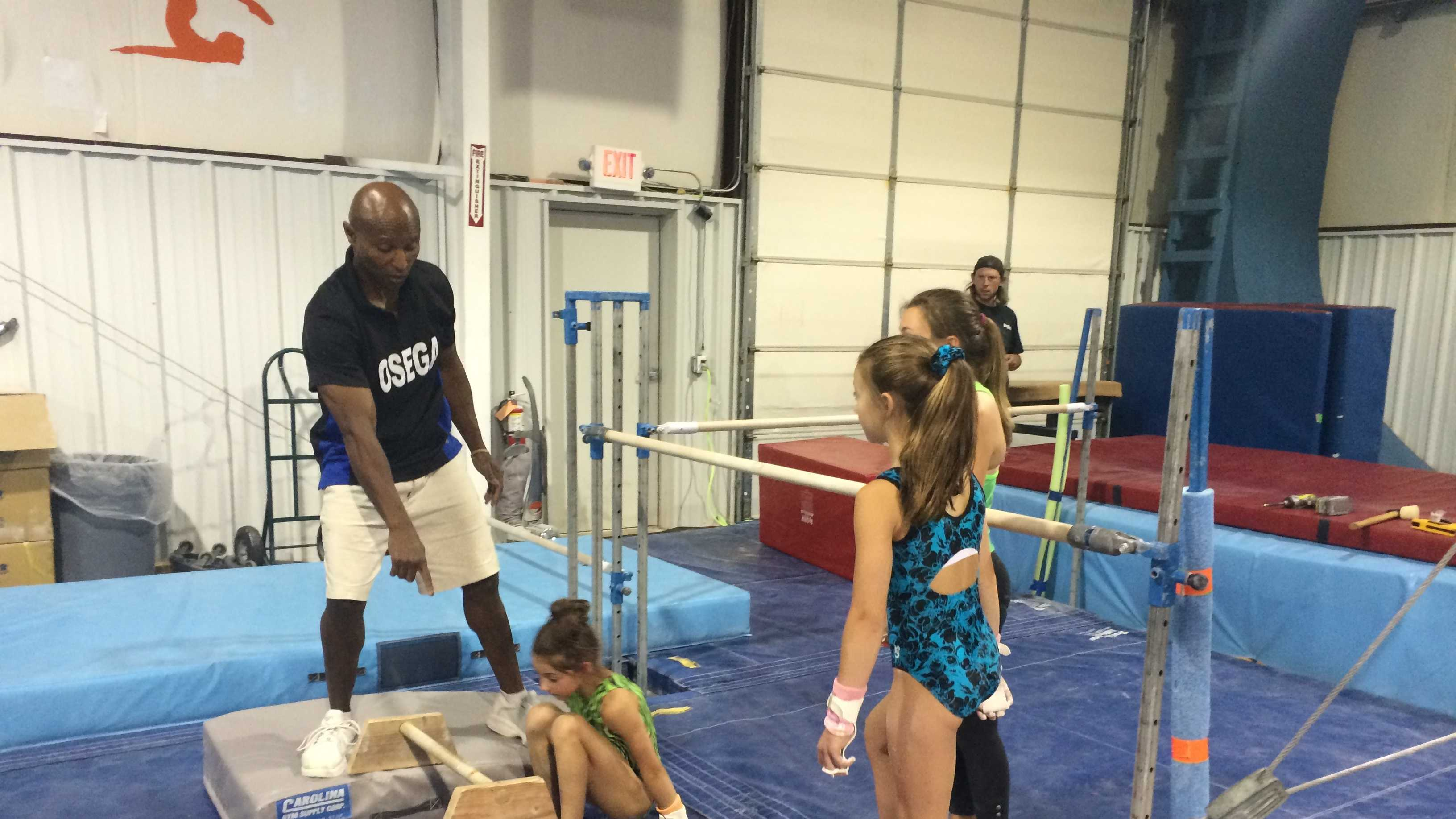 Coach and American Ninja Warrior contestant Miles Avery teaches his students at OSEGA Gymnastics
