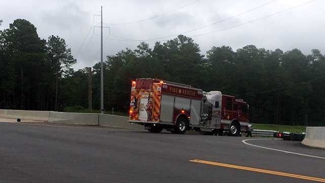 A black helmet can be seen on the left of the fire truck, and the moped is to the right.