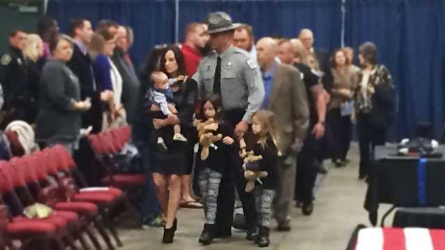 Deputy Brandon Surratt and his family at the memorial for Hyco.