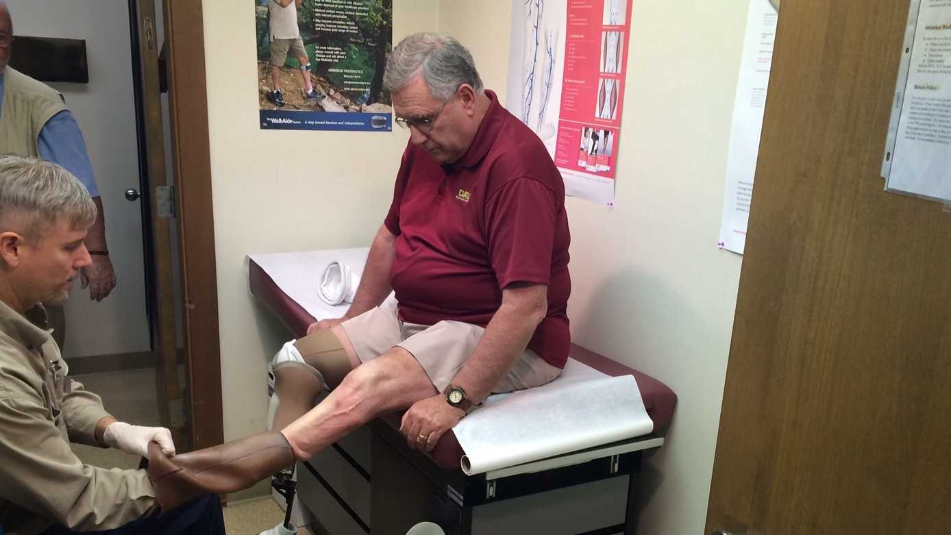 David Gorman getting his prosthetic limbs checked at Advanced Prosthetics.