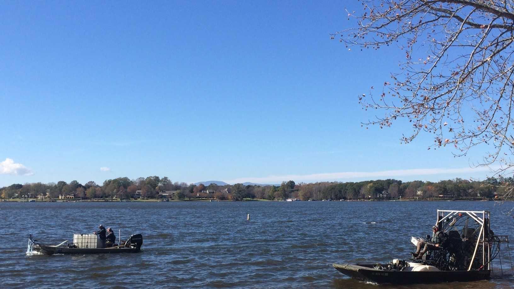 Boats apply algaecide to Lake Bowen.