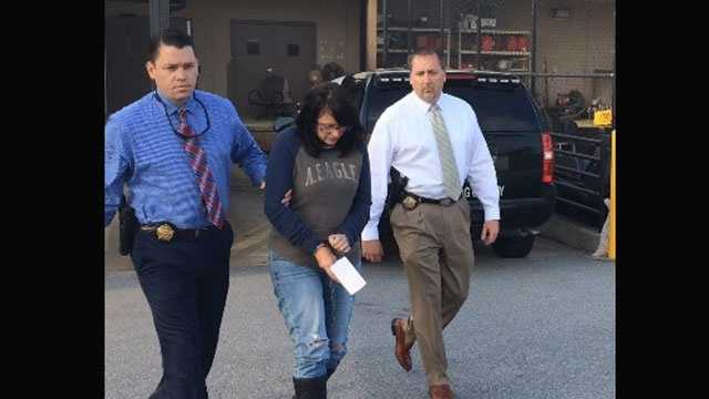 Freida Lynn Lambert-Smith is seen walking to the Spartanburg County Detention Center after she turned herself in there earlier on Thursday.