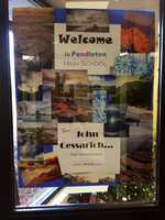 This sign greeted John Cessarich when he visited the school