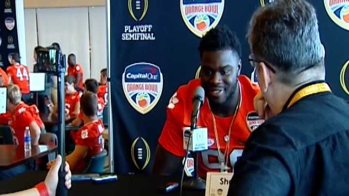 Clemson defensive end and former Daniel High standout Shaq Lawson talks to a reporter during Media Day at the Orange Bowl on Tuesday.