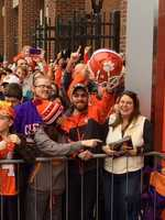 Excited fan with signed Clemson helmet
