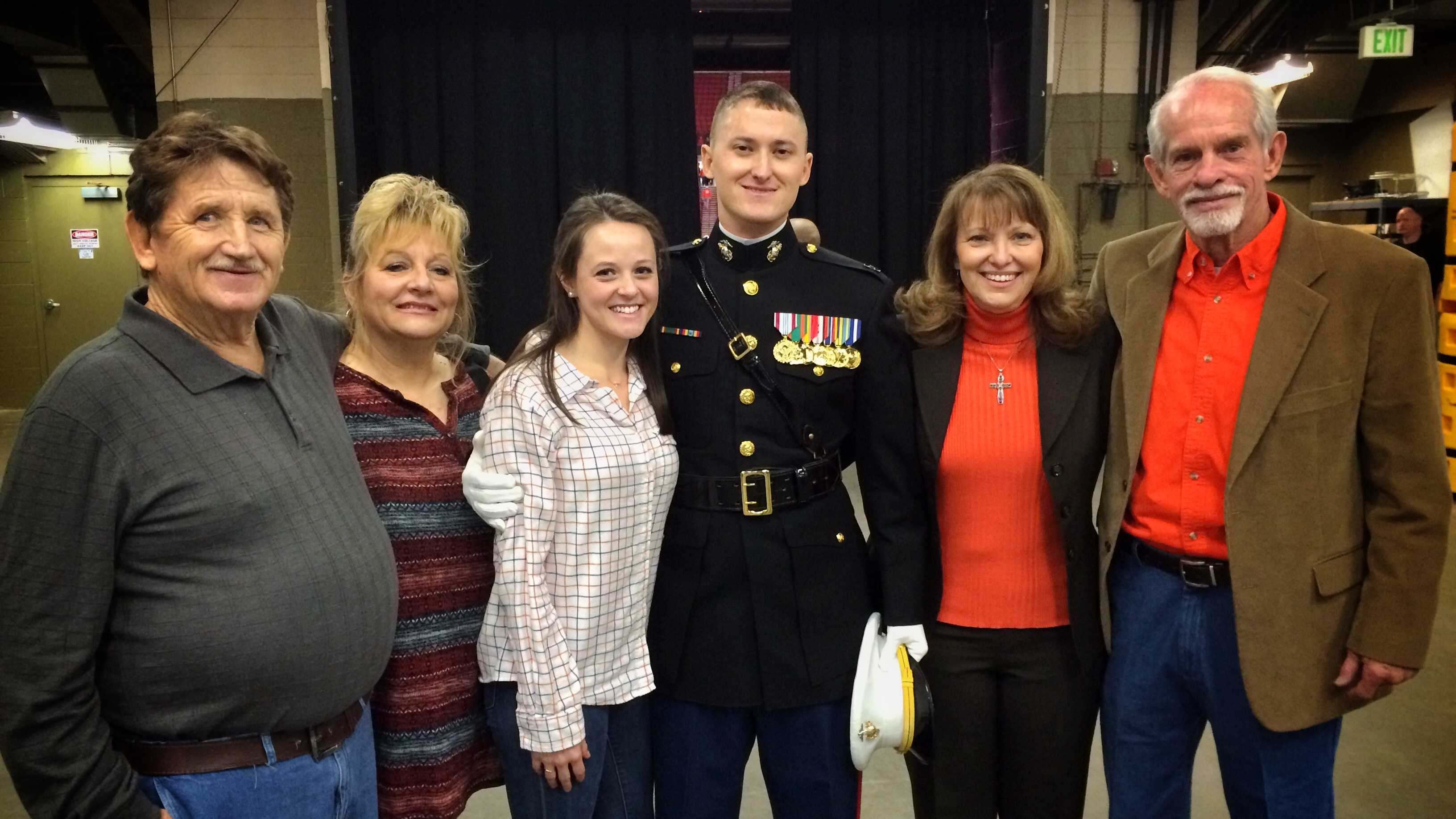 A marine surprised his family and girlfriend at a Clemson Basketball game.