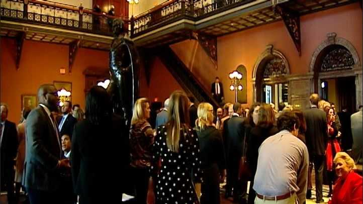 Lobbyists gather in the upper lobby of the statehouse on the first day of the legislative session.