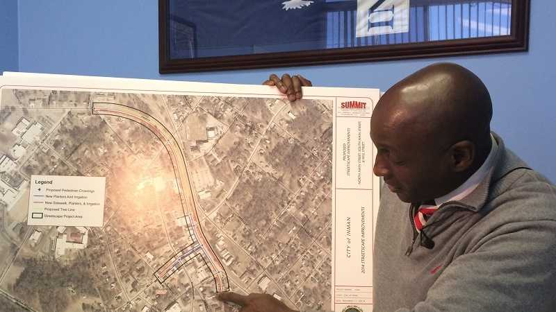 Inman Mayor Cornelius Huff shows off a map showcasing phase one in the city's plan to upgrade its downtown area.