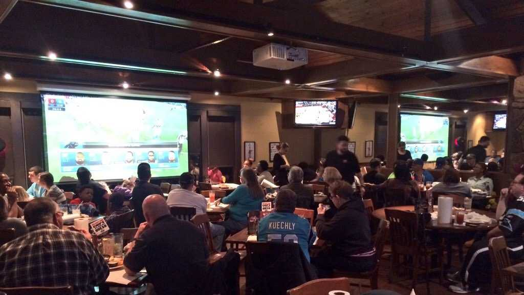 Panthers fans watching NFC Championship at Hickory Tavern in Spartanburg.