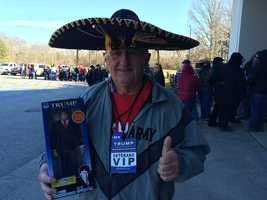 Trump supporter with sombrero and Trump doll