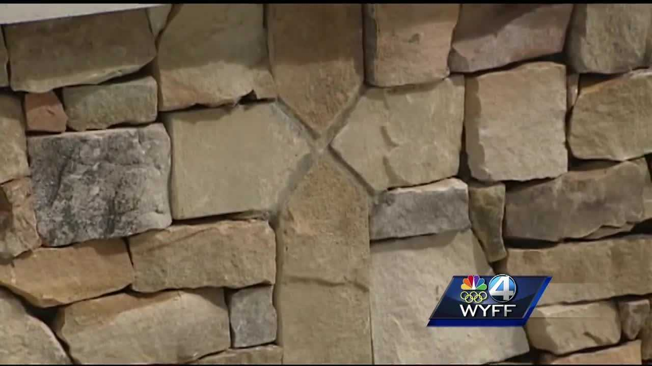 A foundation has filed a complaint about a memorial cross embedded in stonework in Seneca.
