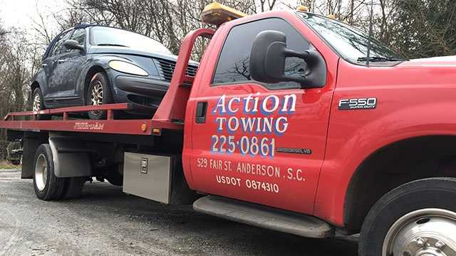 This is the tow truck and the customer's vehicle the driver was picking up when they were struck by and hit-and-run driver on Highway 24 near Airport Road.