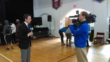 WYFF News 4's Patrick Hussion and photojournalist Jarrett McDaris hard at work