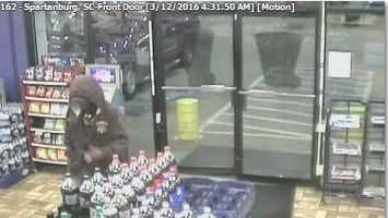 Spartanburg police are looking for a hooded robber who grabbed a convenience store clerk by the neck.