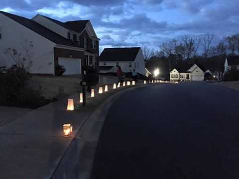 A tribute for Jacobs was held Sunday night. More than 1,500 luminaries were placed up and down sidewalks, along driveways and on porches in Jacobs' parents neighborhood.