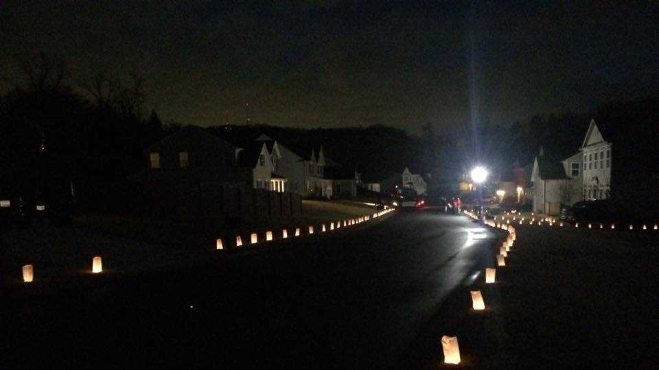 More than 1,500 luminaries placed in neighbor of family of fallen Greenville officer.