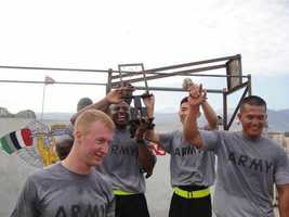 In this picture, Jacobs was taking part in a pull-up competition while doing relief work in Haiti.