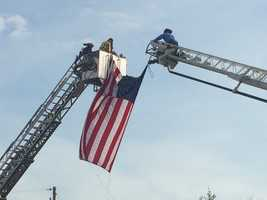 Officer Allen Jacobs' funeral took place Friday at Furman University. This picture was taken early Thursday morning as firefighters were hanging an American Flag on a ladder truck. The ladder truck was then parked on a bridge at Old Buncombe Road and Poinsett Highway that officers passed as they drove to the funeral for Officer Jacobs.
