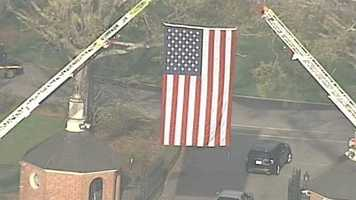 Officers arrive at Furman University for the funeral.