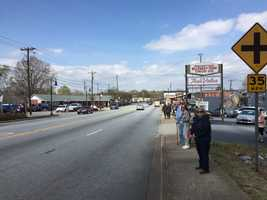 The Greenville/Travelers Rest community lines the streets waiting for the funeral procession