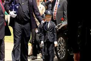 Officer Jacobs's children  in uniform as they leave their father's funeral