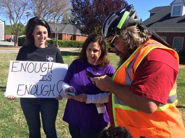 Heather Johnson, in the purple specially-made T-short supporting Grounsell, is the suspended police chief's sister.