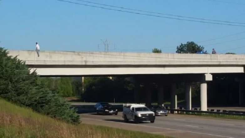 A man tried to jump from a Spartanburg County overpass, but deputies stopped him from taking his own life.