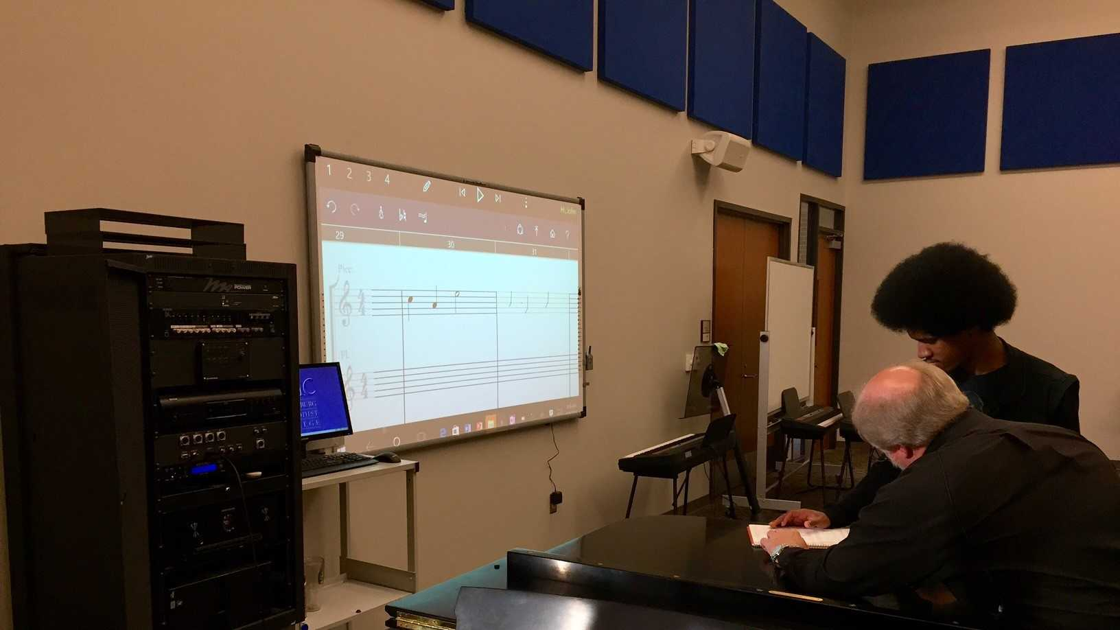 Dr. Lanny Lanford uses technology to help a student bring composed music to life at Spartanburg Methodist College.