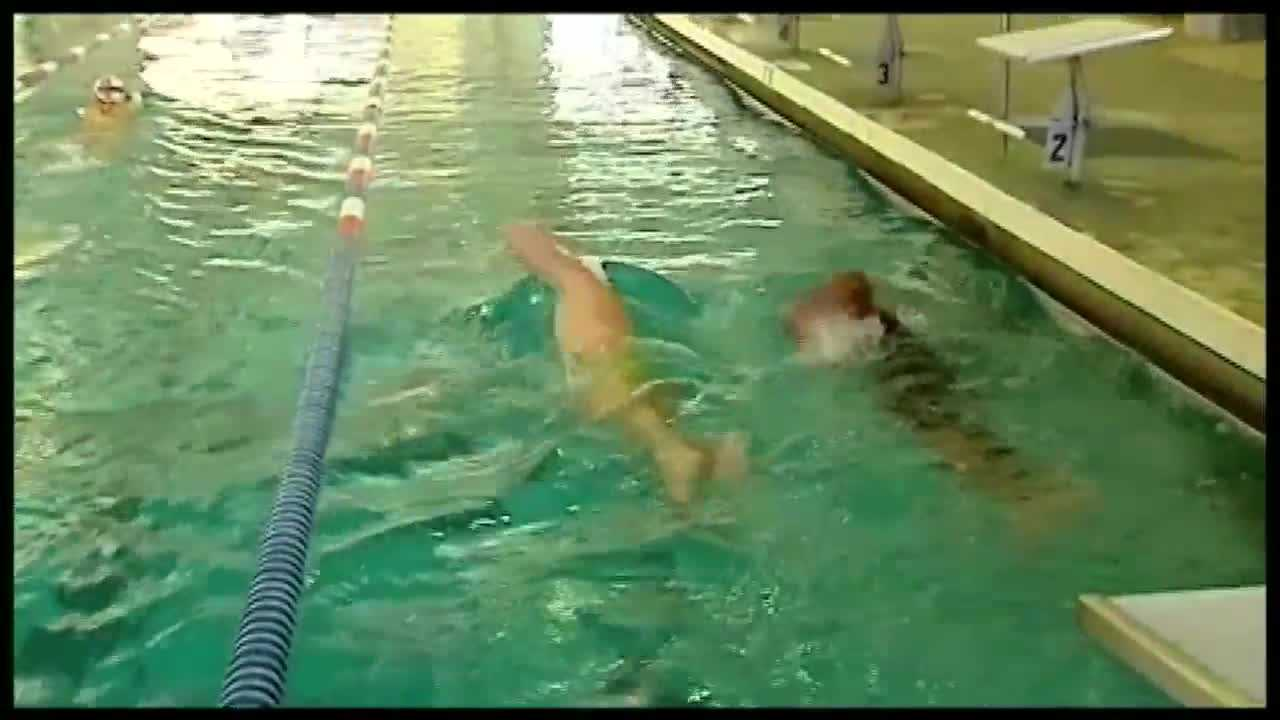 Nigel Robertson trains with Olympic Gold Medalists Tyler Clary and Cammile Adams