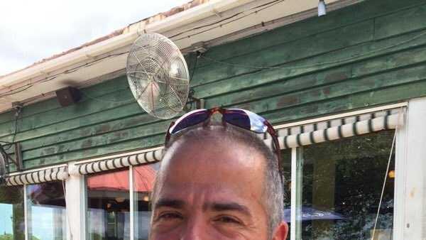 Members of Tom Merlau's work team at GE sent us this photo of Tom.