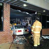 A car crashed into a music school Wednesday evening, leaving behind a gaping hole, fire officials on scene told WYFF News 4.