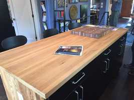 The butcher block island in the kitchen is made from the white oak that used to be on the floors.