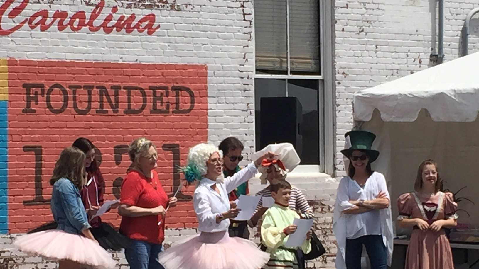 Members of several nonprofits put on costumes and used props for a cheer competition as part of Support Spartanburg County Day.