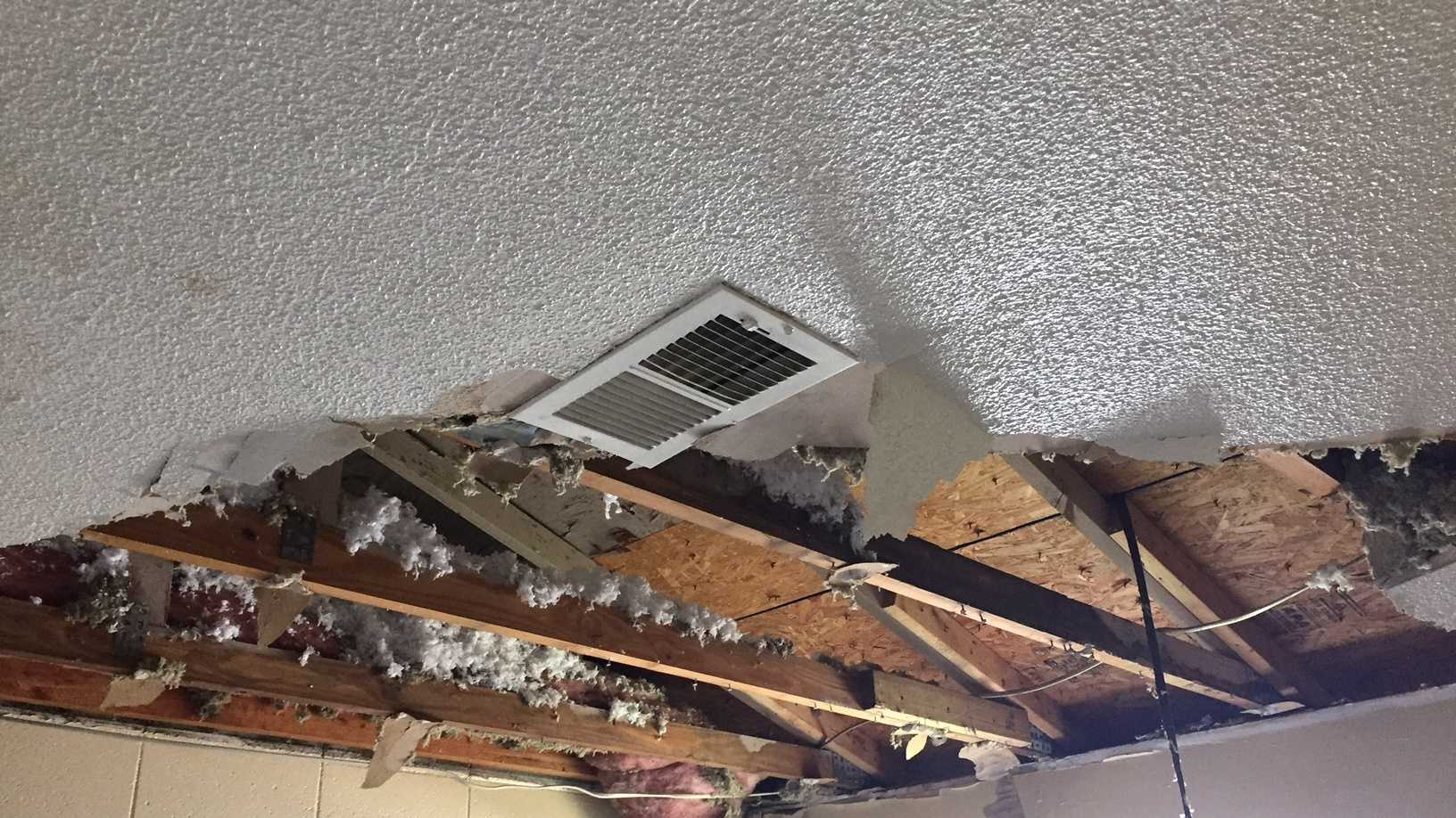 Drywall and insulation fell from the ceiling and left a hole several feet wide.