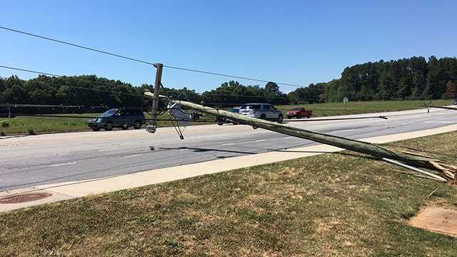 The tractor-trailer hit the pole on Highway 81 in front of T.L. Hanna High School.