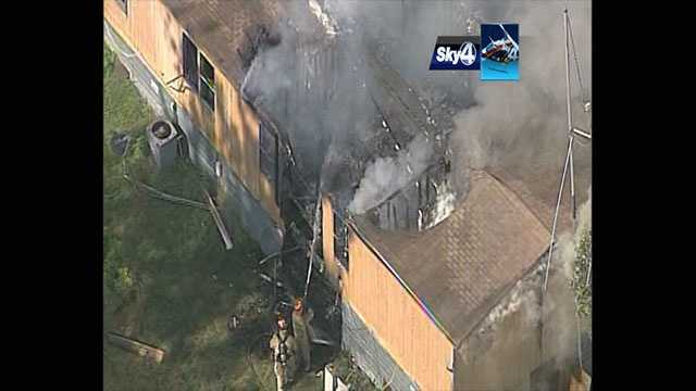 A single-family home was engulfed in flames Friday as WYFF's Sky 4 flew over the scene.
