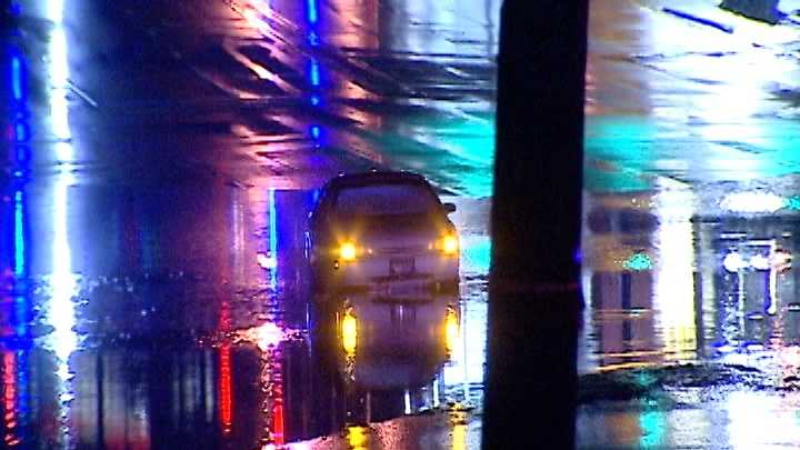 Car stalled in street flooding in Greenville
