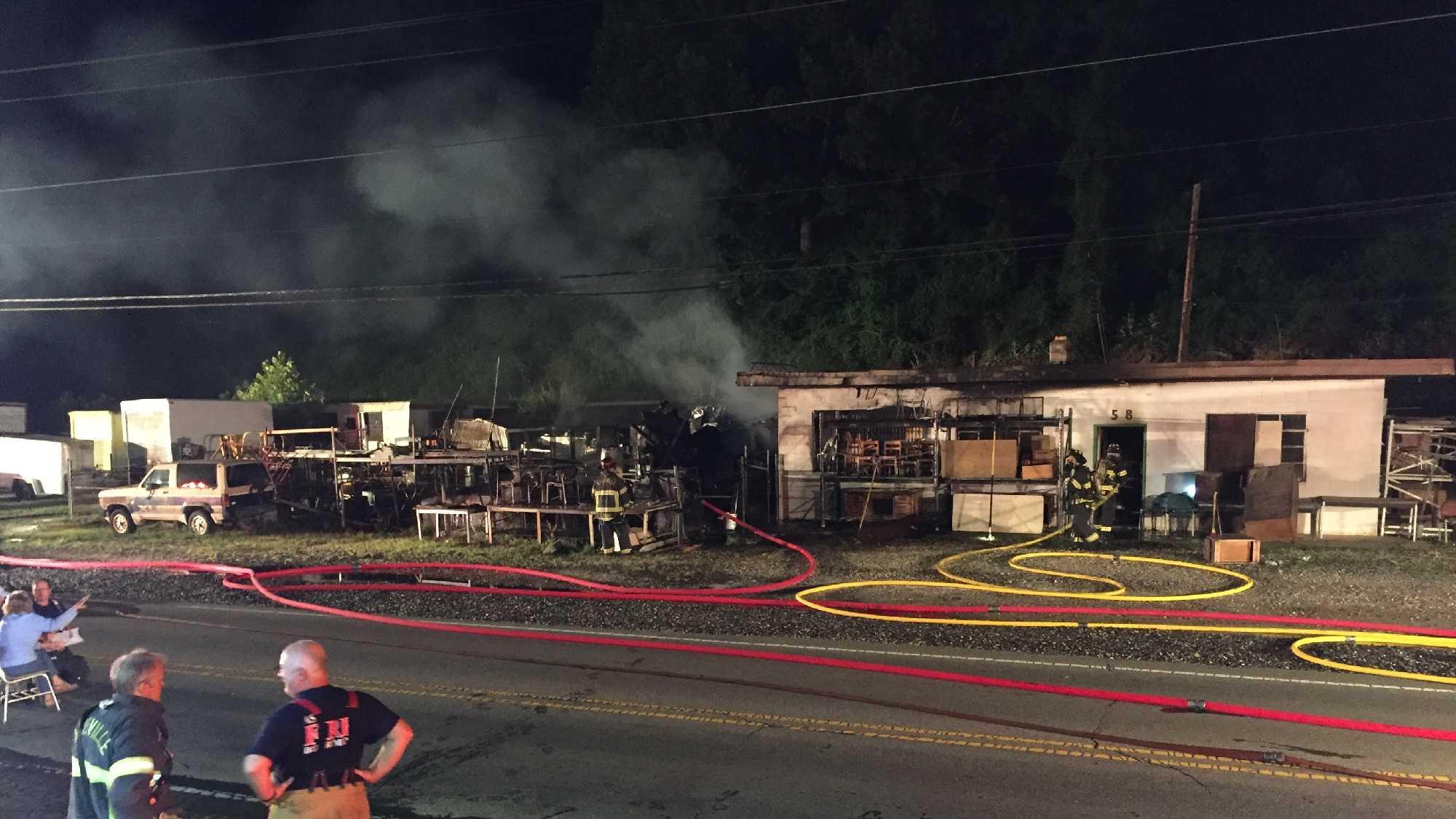 Asheville firefighters work early morning fire on Sweeten Creek Road