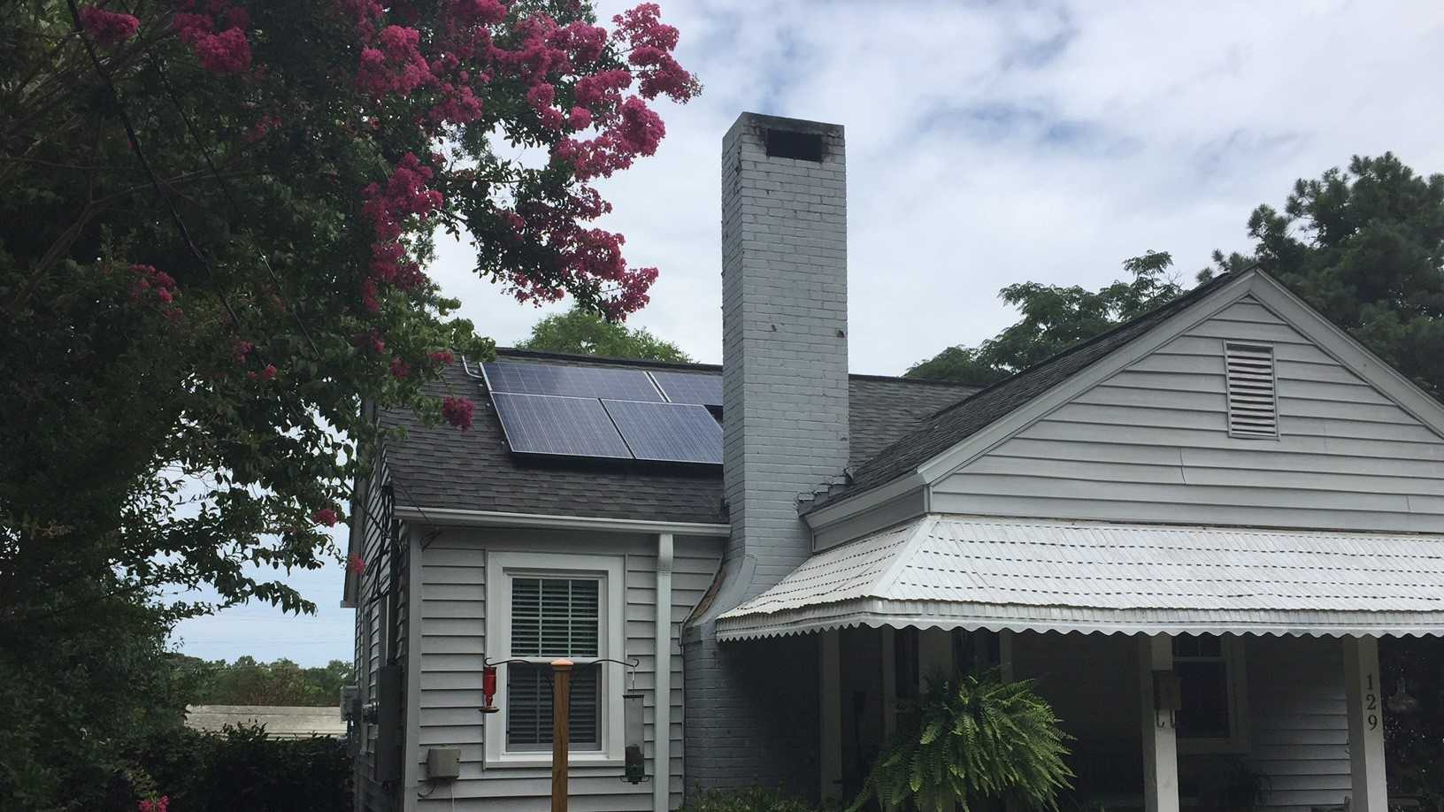 A Spartanburg man said a mistake made by city officials is keeping him using the solar panels on his home.