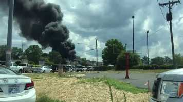 A large fire at ATV Outfitters on Wade Hampton Boulevard sent clouds of black smoke billowing into the air.