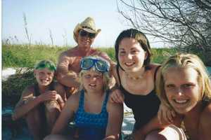 The family also shared this picture of Sandi (far left) from a family vacation in 2003.