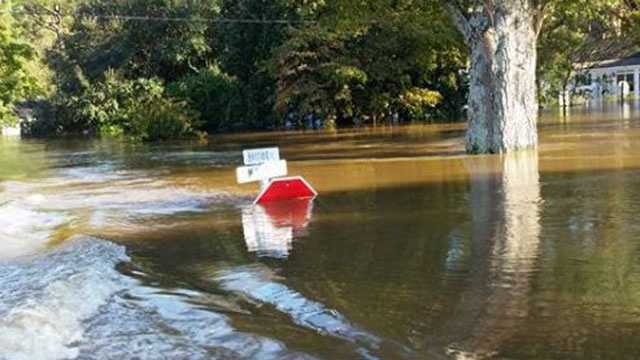 A stop sign is almost completely underwater at an intersection in Seven Springs, North Carolina, near the Neuse River.